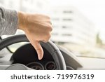 sad driver showing thumbs up in ... | Shutterstock . vector #719976319