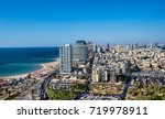 tel aviv skyline in sun set.... | Shutterstock . vector #719978911