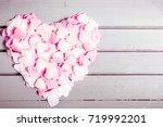 pink hearts on wooden...   Shutterstock . vector #719992201