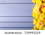 rose flowers leaves on wooden...   Shutterstock . vector #719992219