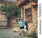 suitor. little boy chatting... | Shutterstock . vector #720002974