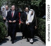 Small photo of Washington DC. USA, 28th September, 1990 President George H.W. Bush with Amir of Kuwait Jabir al-Ahmad al-Jubin Al Sabah walk from the South Portico following a meeting in the Oval Office