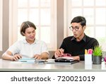 teenage boy studying with home... | Shutterstock . vector #720021019