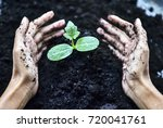 farmer's hands holding and... | Shutterstock . vector #720041761