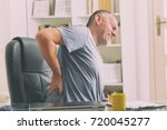 man in home office suffering... | Shutterstock . vector #720045277