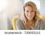 portrait of beautiful 40 year... | Shutterstock . vector #720052111