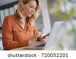 middle aged woman at home... | Shutterstock . vector #720052201