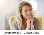 portrait of beautiful 40 year... | Shutterstock . vector #720053401