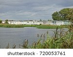a village of holiday chalets...   Shutterstock . vector #720053761
