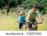 happy couple riding bicycles... | Shutterstock . vector #72007540