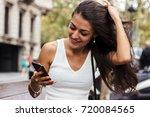 portrait of young attractive... | Shutterstock . vector #720084565