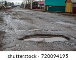 pits with puddles on the road   Shutterstock . vector #720094195