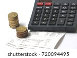 stack of coins  calculator and... | Shutterstock . vector #720094495