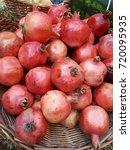 ripe pomegranate fruits....   Shutterstock . vector #720095935