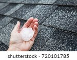 hail in hand on a rooftop after ... | Shutterstock . vector #720101785