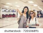 happy women tourist on map to ... | Shutterstock . vector #720106891