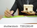 businessmen are writing home... | Shutterstock . vector #720128149