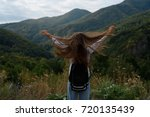 a young girl is traveling in... | Shutterstock . vector #720135439