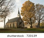 This is a shot of an old church on a foggy Sunday morning. - stock photo