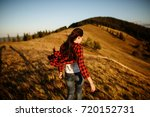 shot of a young woman looking... | Shutterstock . vector #720152731