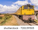 a yellow freight train engine... | Shutterstock . vector #720159505