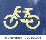 yellow painted sign for bike... | Shutterstock . vector #720161005