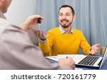mature man and manager signed... | Shutterstock . vector #720161779