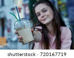smiling woman drinking...   Shutterstock . vector #720167719