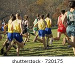 This is a group of runners at the beginning of a cross country race. - stock photo