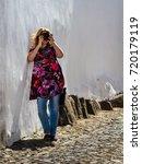 woman enjoying travel... | Shutterstock . vector #720179119