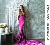 glamorous woman in fashionable... | Shutterstock . vector #720179335