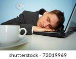 Tired Man Sleeping At Work Wit...
