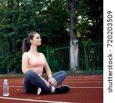 beautiful fitness athlete woman ...   Shutterstock . vector #720203509