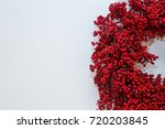 holiday berry wreath on white... | Shutterstock . vector #720203845
