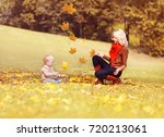 happy family in the autumn...   Shutterstock . vector #720213061