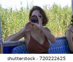 a girl drink bottle of bear in...   Shutterstock . vector #720222625