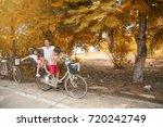 happy family riding bikes...   Shutterstock . vector #720242749