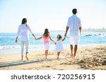 happy family enjoying walk on... | Shutterstock . vector #720256915