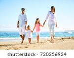 happy family enjoying walk on... | Shutterstock . vector #720256924
