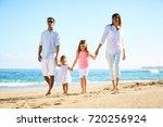 happy family enjoying walk on... | Shutterstock . vector #720256924