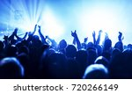 cheering crowd at a rock concert | Shutterstock . vector #720266149