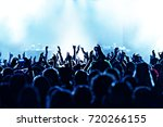 cheering crowd at a rock concert | Shutterstock . vector #720266155
