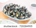 chinese family lunch  mussels | Shutterstock . vector #720284905