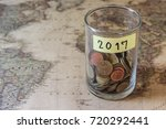 coin in piggy bank with 2017  ... | Shutterstock . vector #720292441