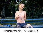 beautiful fitness athlete woman ...   Shutterstock . vector #720301315