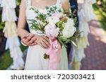 happy bride and groom is... | Shutterstock . vector #720303421