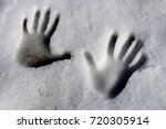 snow hands. two hand prints on... | Shutterstock . vector #720305914