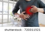 Small photo of MAN with symptomatic acid reflux , suffering from acid reflux