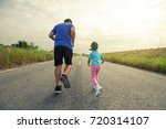 Dad And Baby Jogging In The...