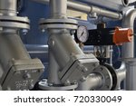 steam piping with fittings on a ... | Shutterstock . vector #720330049